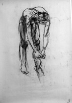 A charcoal life drawing of male model Andres, standing bent over with both arms hanging down in front