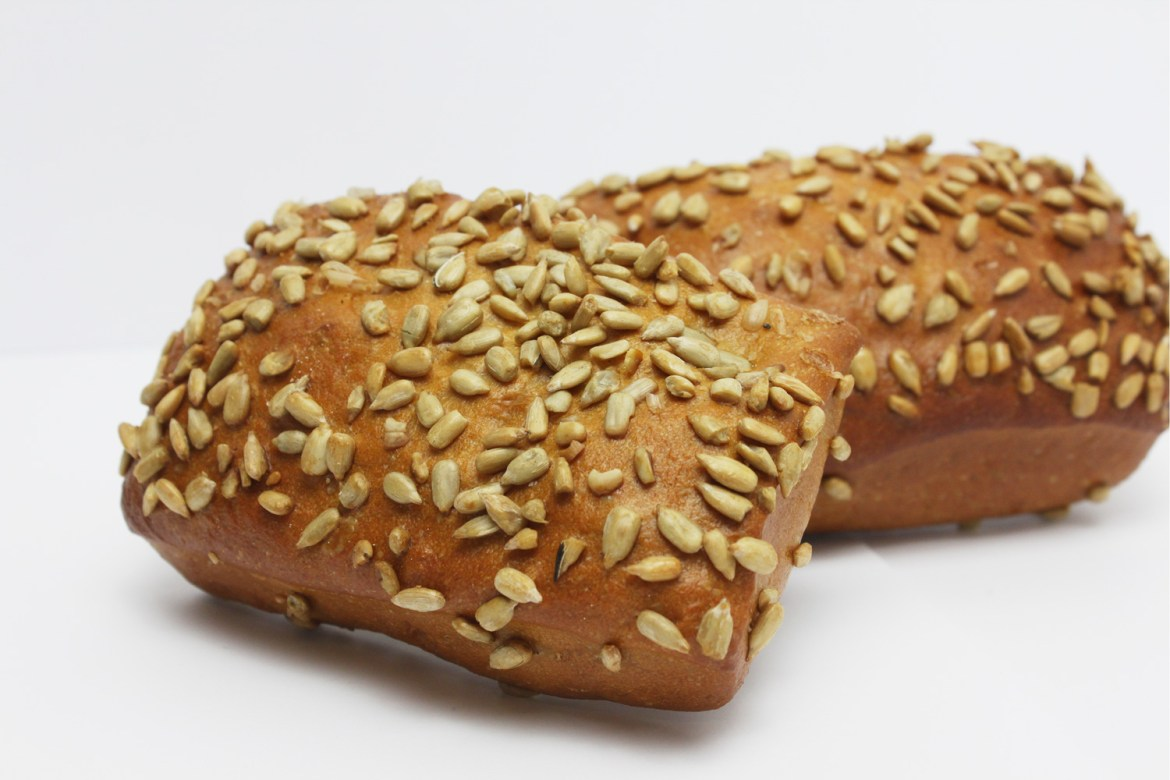 Pumpkin seeds are toasted and used as topping on bread