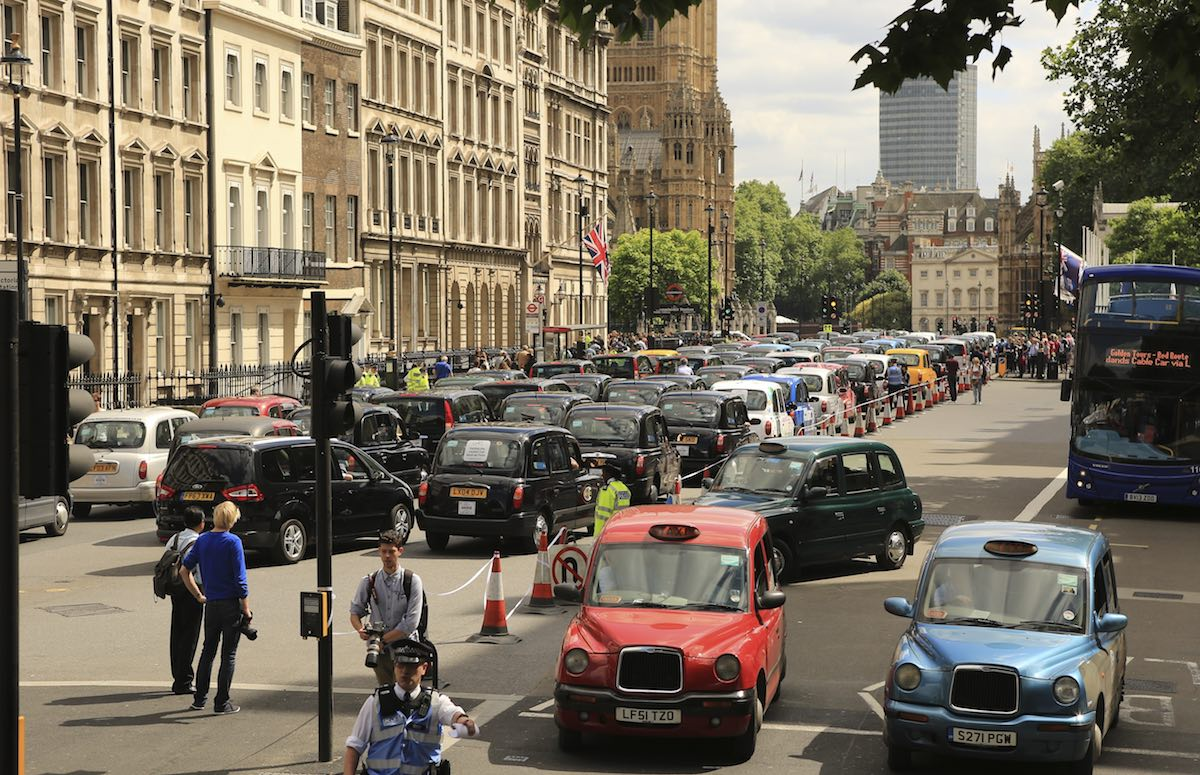 Taxi drivers hold a protest against Uber in Whitehall, London. Image: paula french / Shutterstock.com