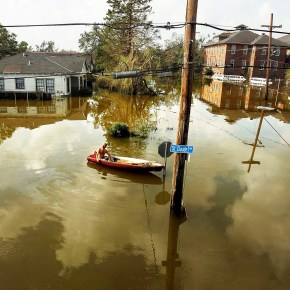 NEW ORLEANS - AUGUST 31:  A man rides in a canoe in high water after Hurricane Katrina devastated the area August 31, 2005 in New Orleans.  (Photo by Mario Tama/Getty Images)