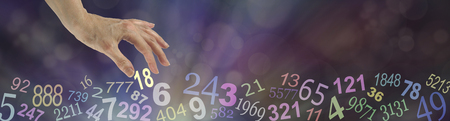 63903924 - numerology wide bokeh website banner - dark multicolored bokeh background with transparent numbers randomly placed along the bottom and a female hand choosing the number 18