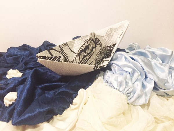 PAPER SHIPS ON A CLOTH SEA