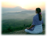 Woman-meditating-sunrise