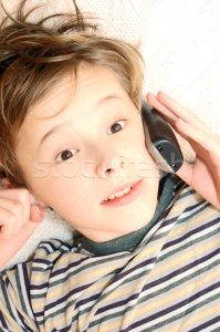 1530292_stock-photo-teen-boy-talking-on-cell-phone