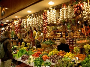 Strings of garlic and fresh produce abound in the Enoteca Lombardi.