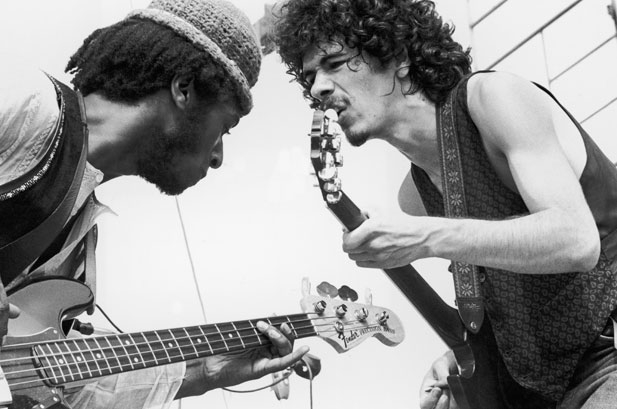 August 1969: Mexican-born guitarist Carlos Santana (right) and bassist David Brown perform with the group Santana at the Woodstock Music Festival