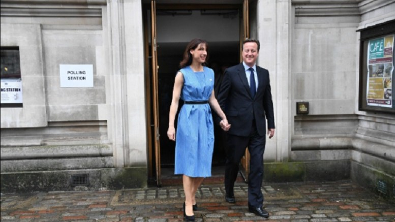 File Photo: British PM David Cameron with wife Samantha after casting their vote.