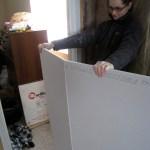 Scoring and breaking drywall.