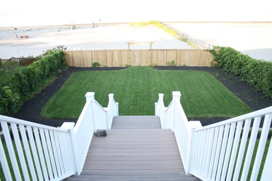 After: View of the beach and freshly landscaped backyard from the deck.