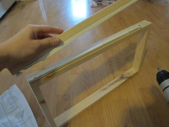 Determining where the drawer sliding track needs to sit to match up to its mate on the wall.