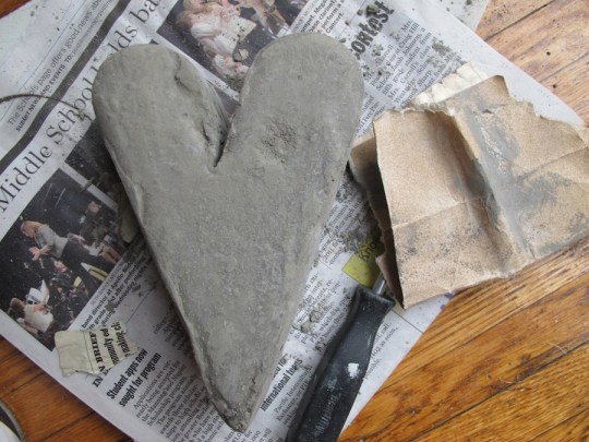 Lightly sanding the curing cement smoothed out rough edges and lumps.