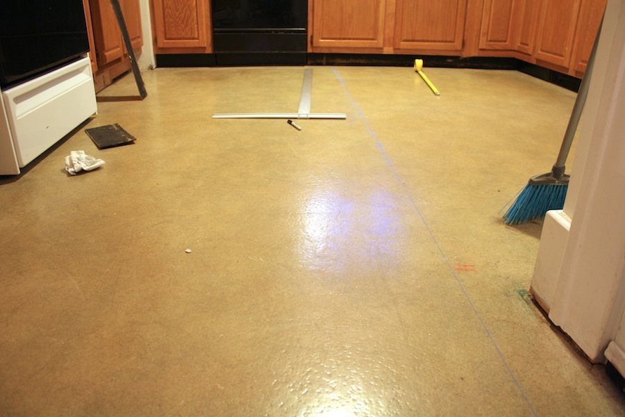 Preparing to lay floor tiles over vinyl sheet flooring for Preparing floor for vinyl
