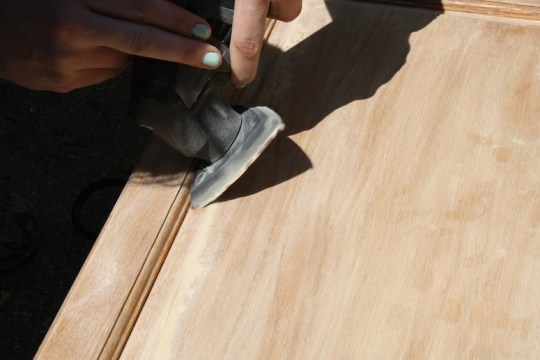 Getting into the angles of the cabinet door with the sanding attachment on the multi-tool.