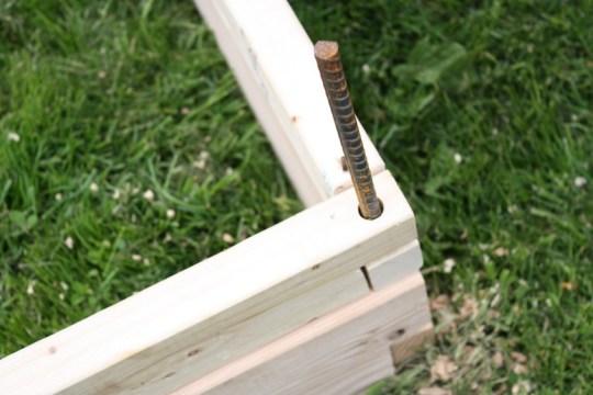 Pinning rebar into the corner of the box planter.