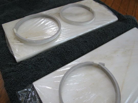 Preparing the coaster molds on a smooth marble surface.