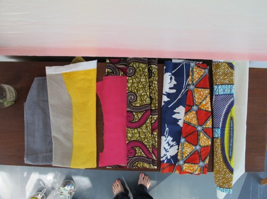 Assorted fabrics to be used for the seat cushions.