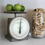 Accent decor in the kitchen: Vintage scale and container of corks.