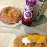 Typical breakfast. Pastries, coffee, fruit juice.