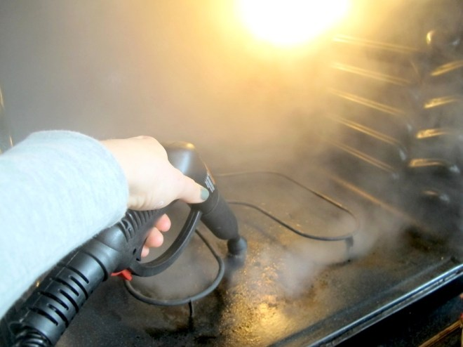 The HomeRight SteamMachine cleaning the inside of my oven.