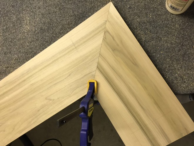 Clamping mitered angles for DIY shelving.