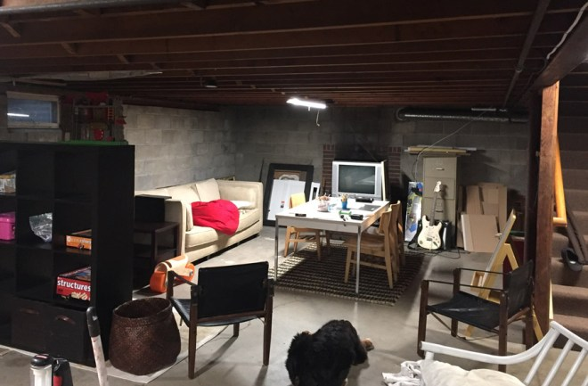 Our unfinished basement art room, before.