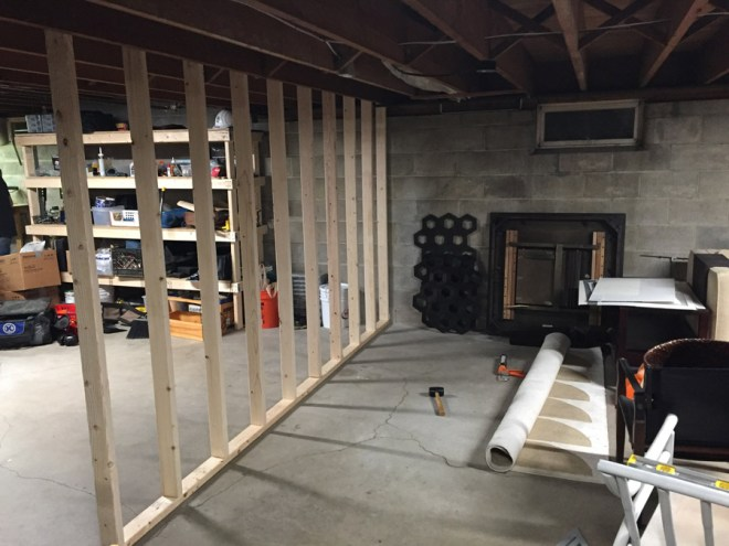 Building walls in a basement art room.