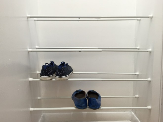 Use tension rods to store shoes in a closet.