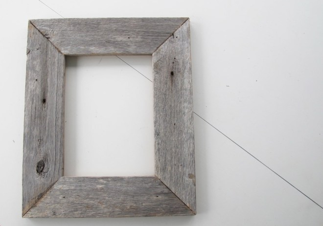 DIY rustic wreath made of a reclaimed wood picture frame.