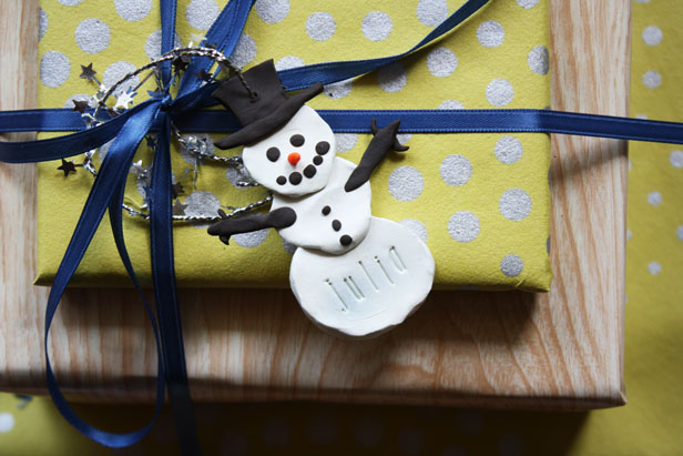 Make a custom clay gift tag that can be used as a personalized ornament.