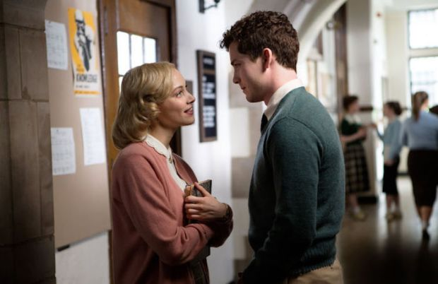 Logan Lerman and Sarah Gadon look at each other in Indignation