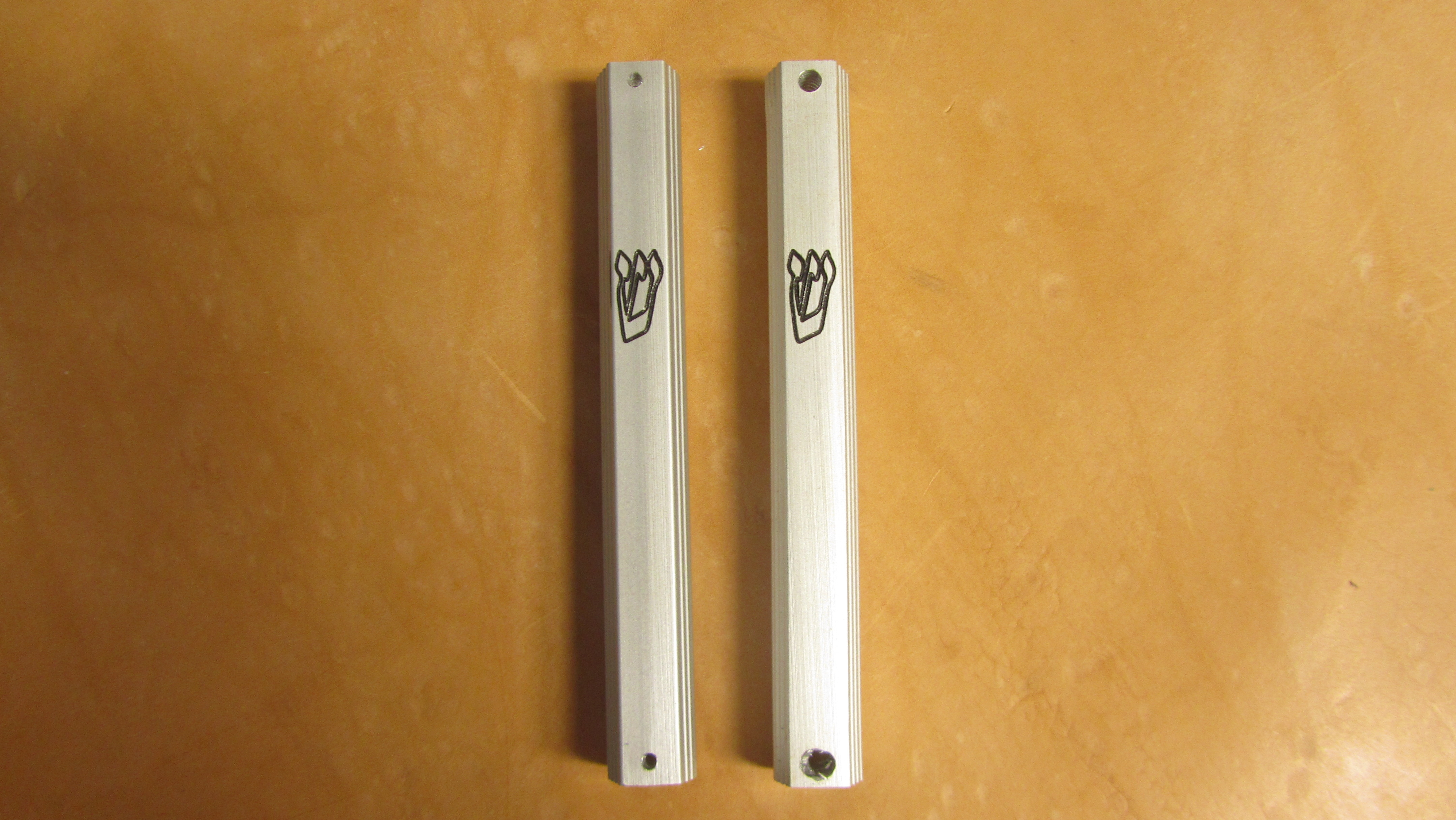 Metal mezuzah case on the left withstandard screw holes right with enlarged screw holes for & Mezuzah Checking Mezuza House Calls Mezuzos House Calls | Tefillin ...