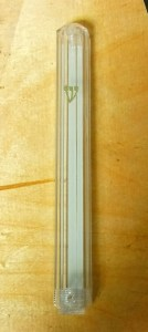 Clear with double sided tape and screw on bottom for easy removal of mezuzah: $6.00