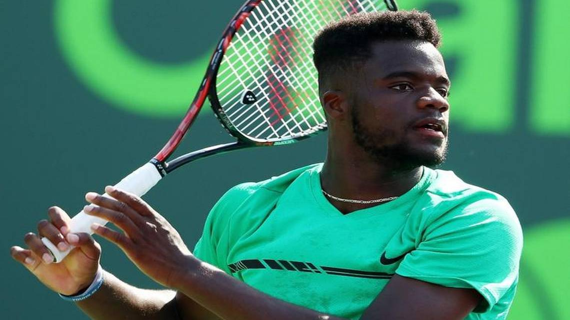 frances tiafoe s victory sets up date with legend roger federer miami herald