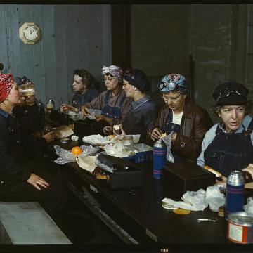 Women workers employed as wipers in the roundhouse having lunch in their rest room, Chicago and Northwest Railway Company. Clinton, Iowa, April 1943. Reproduction from color slide.