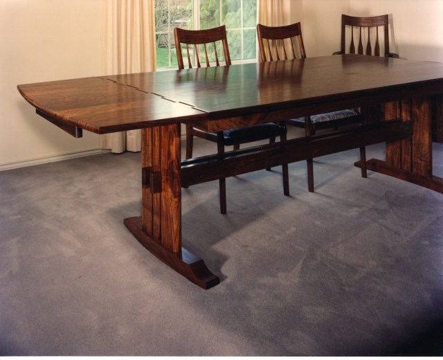 A knuckle joint, drop leaf table in Walnut
