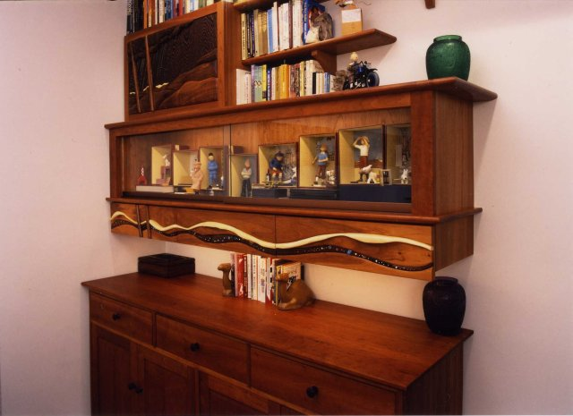 Wall mounted display cabinet with earring storage