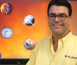 Microassist CTO Hiram Kuykendall with display of OpenAIR accessibility training game