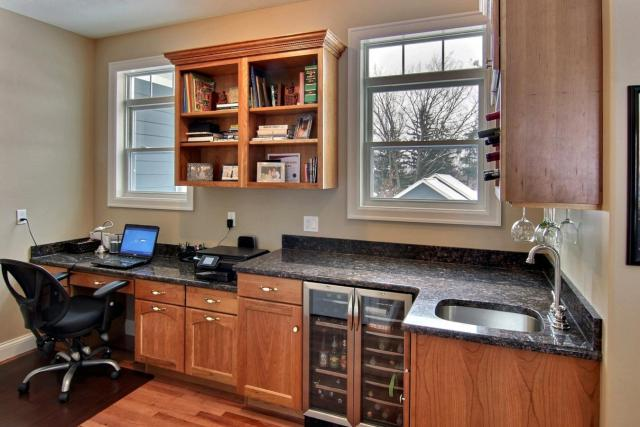 Office area with optional wetbar and custom built-in desk and bookshelves (116 FWHD)
