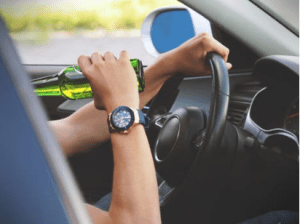 man drinking while driving