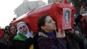 Women carry the coffin of Sirin Oter, one of two women killed during security operations on Tuesday, during a funeral ceremony in Istanbul, Wednesday, Dec. 23, 2015. Security forces have killed 145 Kurdish rebels in a week in southeast Turkey, news agencies reported. The government imposed curfews in the mainly Kurdish towns of Cizre, Silopi and Sur as the security forces battle militants linked to the Kurdistan Workers' Party, or PKK who have moved their fight.