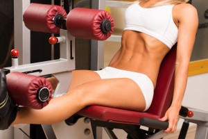 Gym fitness club indoor with young women training weights with legs