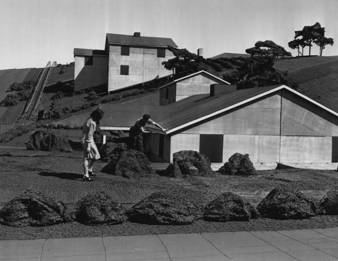 suzette-lamoureaux-and-vern-manion-examine-one-of-the-miniature-bungalows-in-the-boeing-wonderland-boeing-seattle-times-archive