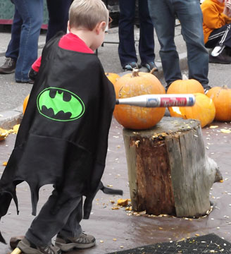 Superhero goes after tough pumpkin at the 2011 Pumpkin Smash.