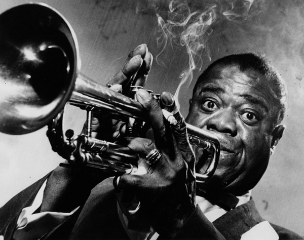 From published caption: Louis Armstrong playing his trumpet in a halo of smoke (10/31/1957)