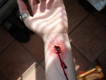 trauma, wound, sfx make up, special effects makeup, wax, liquid latex, blood stigmata, puncture wound, wrist