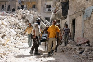 Syrian Civil Defence workers evacuate a body following a regime air strike on May 17, 2016, in the rebel-held al-Sukari neighborhood of the northern city of Aleppo. A regime air strike in key battleground city Aleppo left at least three civilians dead early Tuesday, among them a mother and her young daughter, according to the Syrian Observatory for Human Rights. / AFP PHOTO / THAER MOHAMMED