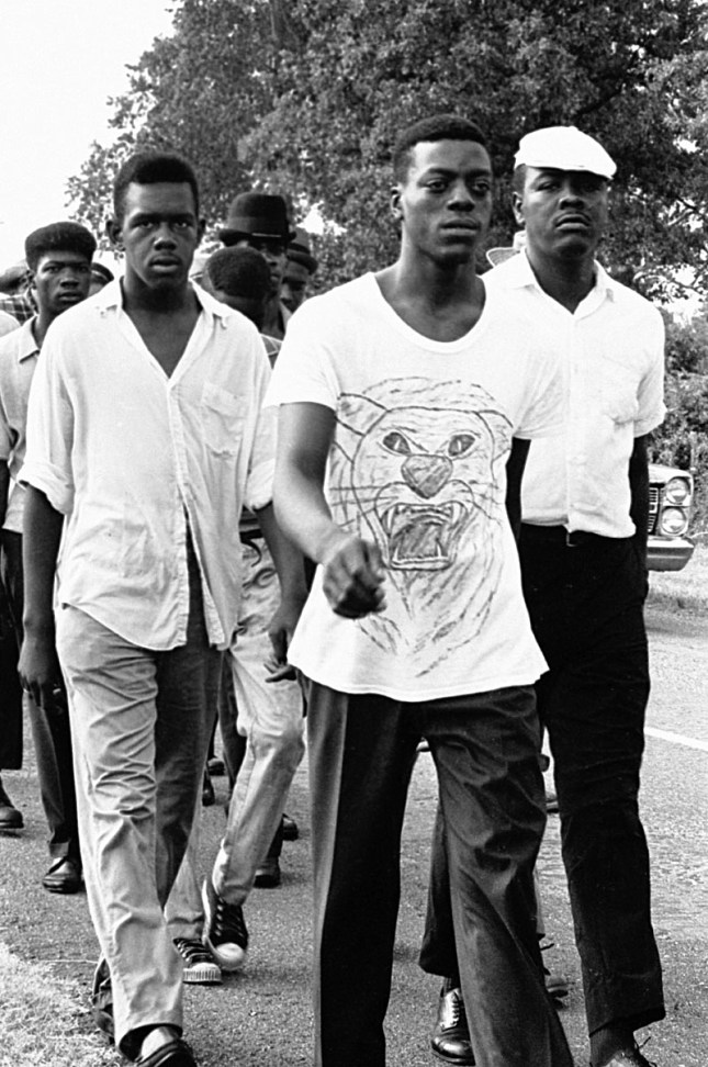 Photo: Maria Varela, near Canton, Mississippi, 1966: A hand-drawn black panther indicates a change of movement symbolism as young men joined the Meredith March in response to the call for Black Power.