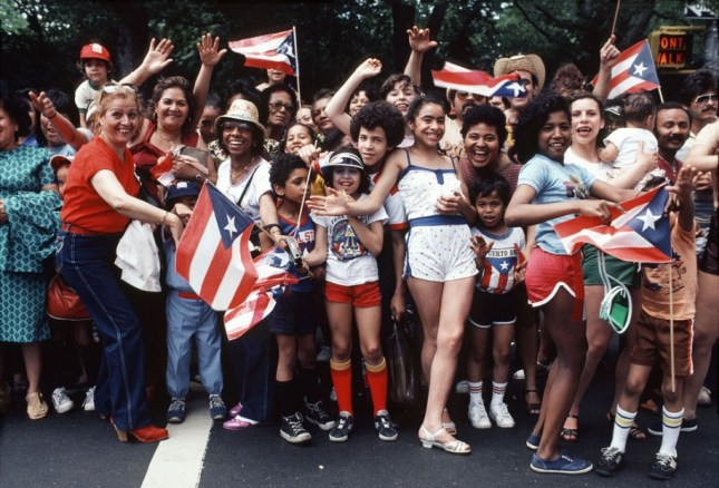 Photo: Puerto Rican Day Parade. ©Arlene Gottfried, courtesy of Daniel Cooney Fine Art.