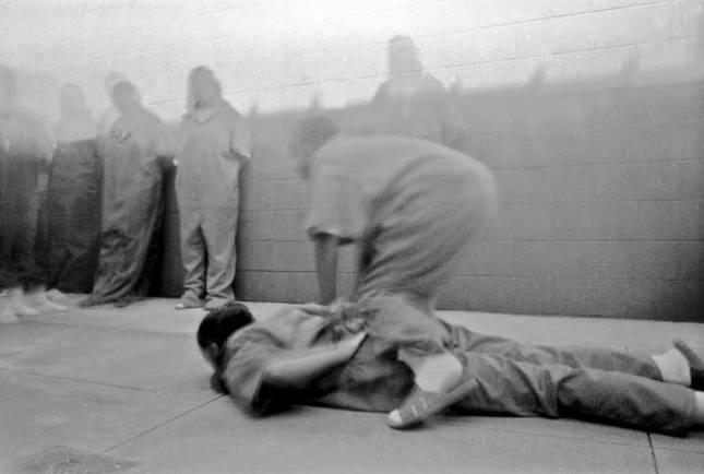 Photo: Anonymous, courtesy of Steve Davis, Incarcerated girls at Remann Hall, Tacoma, Washington, reenact restraint techniques in a pinhole camera workshop, 2002.