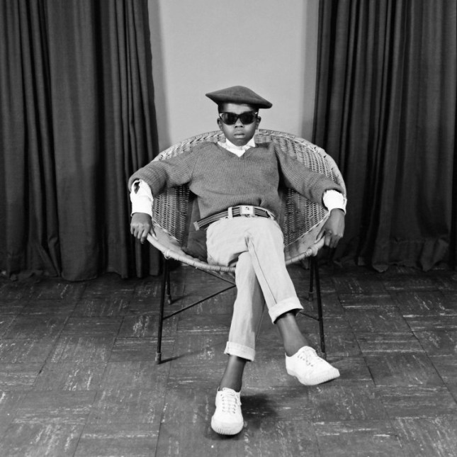 Photo: S. J. Moodley, [Boy with sunglasses in a chair], ca. 1978. Courtesy The Walther Collection.